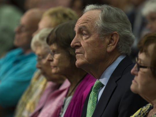 Senator Tom Harkin listens in the audience of the debate to fill his seat at the end of his term.