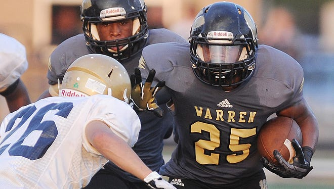 Warren Central RB Tirone Young, shown here Aug. 30, rushed for 118 yards and scored three first quarter touchdowns Friday as the Warriors beat Lawrence Central.