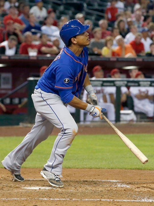 New York Mets' Juan Lagares flies out to right field during the third inning of a baseball game against the Arizona Diamondbacks on Monday, April 14, 2014, in Phoenix.  Lagares had to leave the game early, but the Mets defeated the Diamondbacks 7-3. (AP Photo/Ross D. Franklin)