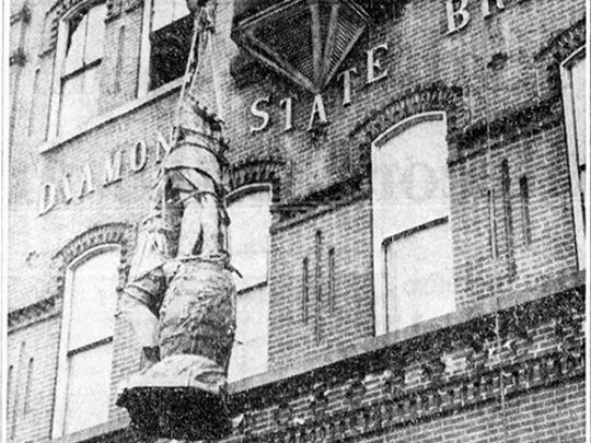 The King Gambrinus statue is lowered from its home at the Diamond State Brewery in Wilmington in 1962, making way for I-95.