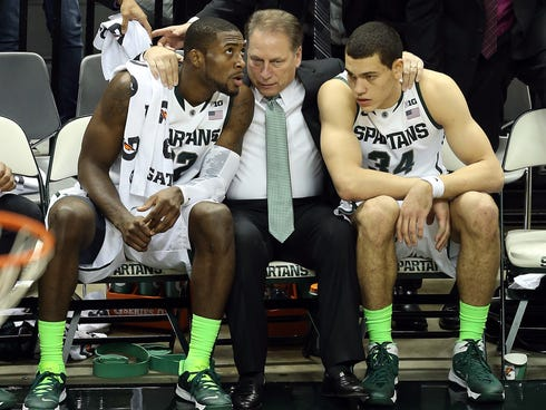 Michigan State Spartans head coach Tom Izzo talks with guard/forward Branden Dawson (22) and forward Gavin Schilling (34) on the bench in the second half against the McNeese State Cowboys at Jack Breslin Student Events Center.