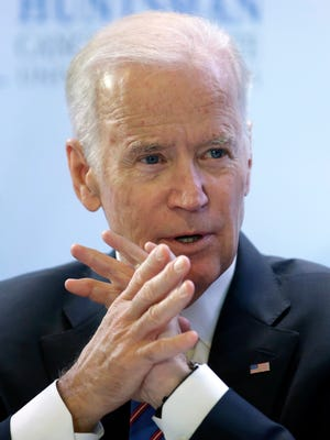 """Vice President Joe Biden participates in a roundtable on cancer after a tour of the research lab at the Huntsman Cancer Institute Friday, Feb. 26, 2016, in Salt Lake City as part of the White House's cancer """"moonshot."""""""