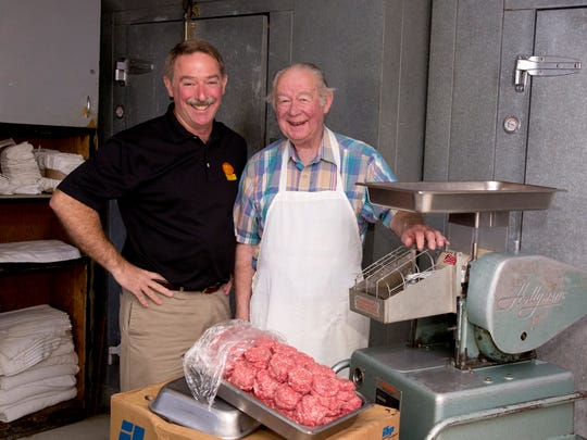 Greg Ehresman with his father Jack. Jack Ehresman still comes in every morning to cut the meat at Triple XXX.