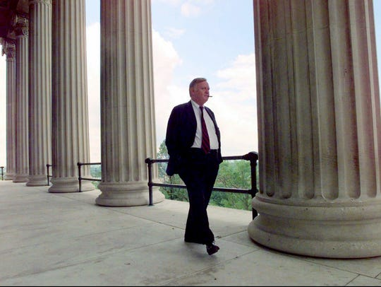 Sen. Douglas Henry takes a walk on a balcony of the
