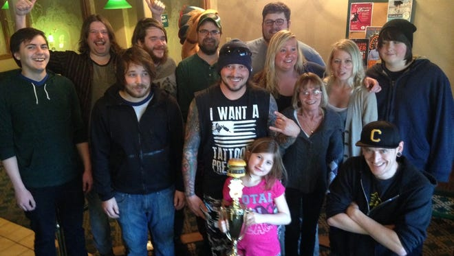 The Skelly's crew with the Downtown Burger Battle trophy.