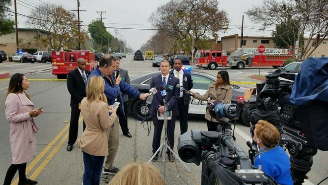 The shooting death of a Pomona police officer is discussed by Los Angeles County Sheriff's Capt. Christopher Bergner at a press briefing Saturday morning in Pomona.