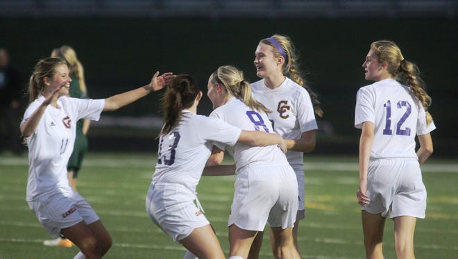 The Camels celebrate a goal by junior Taylor Jolly, (8), middle. Bishop Brossart played at Campbell County in girls soccer Sept. 17, 2014 at Campbell County HS.