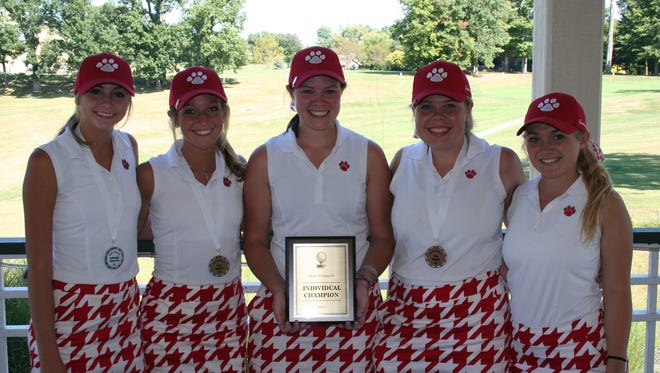 Beechwood won the Northern Kentucky Athletic Conference Division II girls' golf championship Tuesday at Boone Links. Division II individual champion Jenna McGuire holds the medalist trophy.