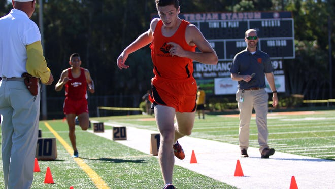 Lely's Josh Wagner reaches for the finishline during Friday morning's District 2A-12 meet at Lely High School.