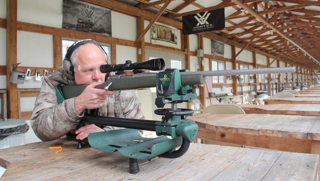 Tony Gailloreto takes aim during a rifle sight-in session at the range at Milford Hills Hunt Club in Johnson Creek, Wis.