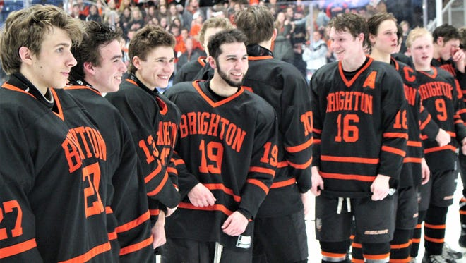 Brighton players are all smiles as they line up for awards after winning the Division 1 state final on Saturday, March 10, 2018.