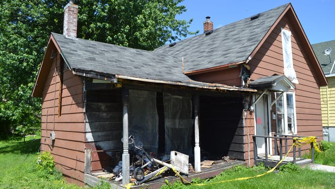 The Oconto City Council has approved razing this house at 109 Huron Ave., which was gutted by a fire on April 8.