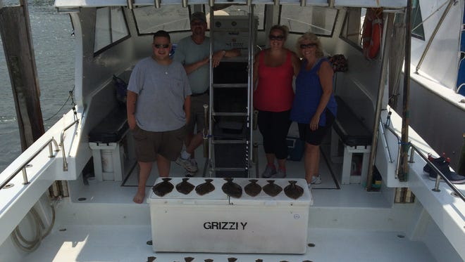 Great day of fishing for Justin Mohajer and family aboard The Grizzly. Not only did they limit out on flounder but also caught some sea bass.