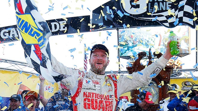 Dale Earnhardt Jr. celebrates in Victory Lane after winning the NASCAR Sprint Cup Series Goody's Headache Relief Shot 500 at Martinsville Speedway on Sunday.