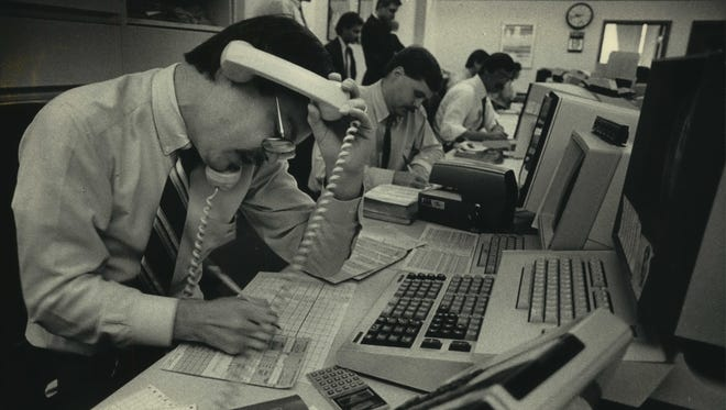 Al Herman tries to keep up with the flood of customer calls at Milwaukee brokerage firm Blunt Ellis & Loewi on Oct. 19, 1987. This photo was published on the front page of the Oct. 19, 1987, Milwaukee Journal.