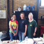 (right to left) Sharon Cecil, Jenniffer Truitt and a student volunteer help out at LightFest's Firehouse Fest on May 5. The day was meant to teach fire safety. (photo submitted by Sharon Cecil)