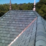The two finials installed on the roof of a home are part of a lightning protection system installed by Ohio Valley Lightning Protection. The firm, based in the Wilmington area, said the average system for residential customers costs $2,000 to install.