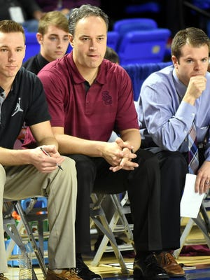 Former Station Camp coach Caleb Cook, right, has been named the new White House boys basketball coach.