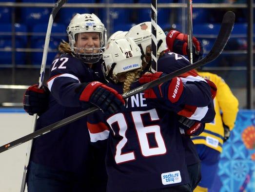 USA forward Brianna Decker (14) celebrates with her teammates including defenseman Kacey Bellamy (22) after scoring a goal against Sweden.