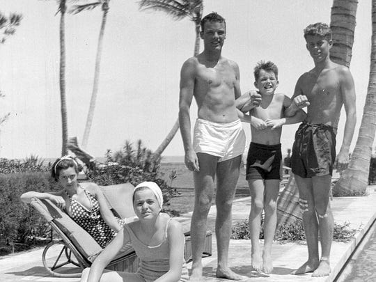 America's future president, John F. Kennedy, right, and Robert F. Kennedy, second from right, pose with friends and Patricia Kennedy, front left, in Palm Beach, Fla., in 1936.