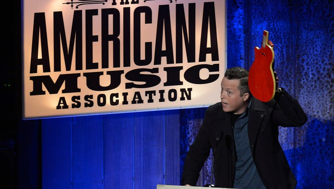 "Jason Isbell accepts the Song of the Year Award for "" Cover Me Up"" during the Americana Music Honors and Awards show Wednesday, Sept. 17, 2014, in Nashville, Tenn. (AP Photo/Mark Zaleski)"