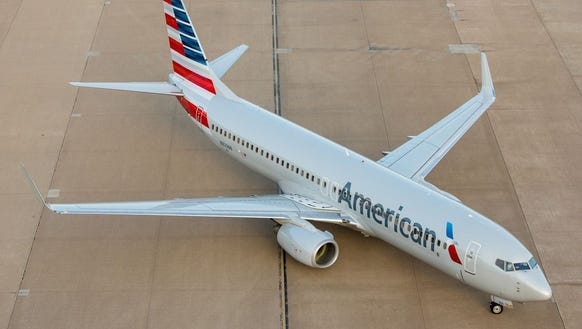 An American Airlines Boeing 737 taxis into a gate at
