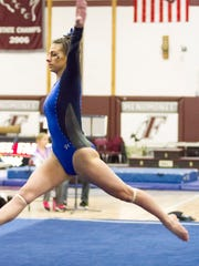 Brookfield senior Caitlin Locante, pictured competing on the floor exercise at sectionals, won the state floor title on March 4 by setting a new state record.