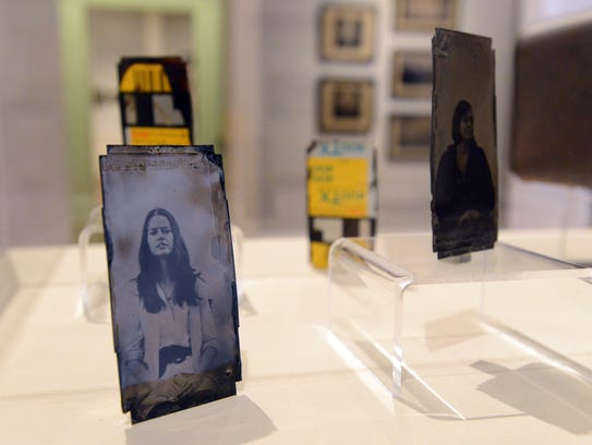 A display of portraits created by David Emitt Adams