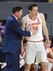 Clemson head coach Brad Brownell coaches forward David Skara (24) as the Tigers play Duke during the 1st half on Sunday, February, 18 2018, at Clemson's Littlejohn Coliseum.