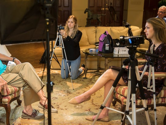Hannah Legutki, 18, center, and Dayna Grigsby, 17, interview a Korean War veteran on August 3, 2016 in Naples, Florida. Legutki and Grigsby, both juniors at Naples High and Barron Collier, respectively, have launched an initiative to capture video interviews with Korean War veterans, providing first-hand accounts and memories of the 1950-1953 war.