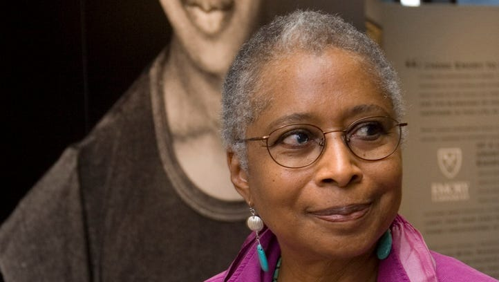 Alice Walker stands in front of a picture of herself from 1974 as she tours her archives at Emory University, in Atlanta, on April 23, 2009.