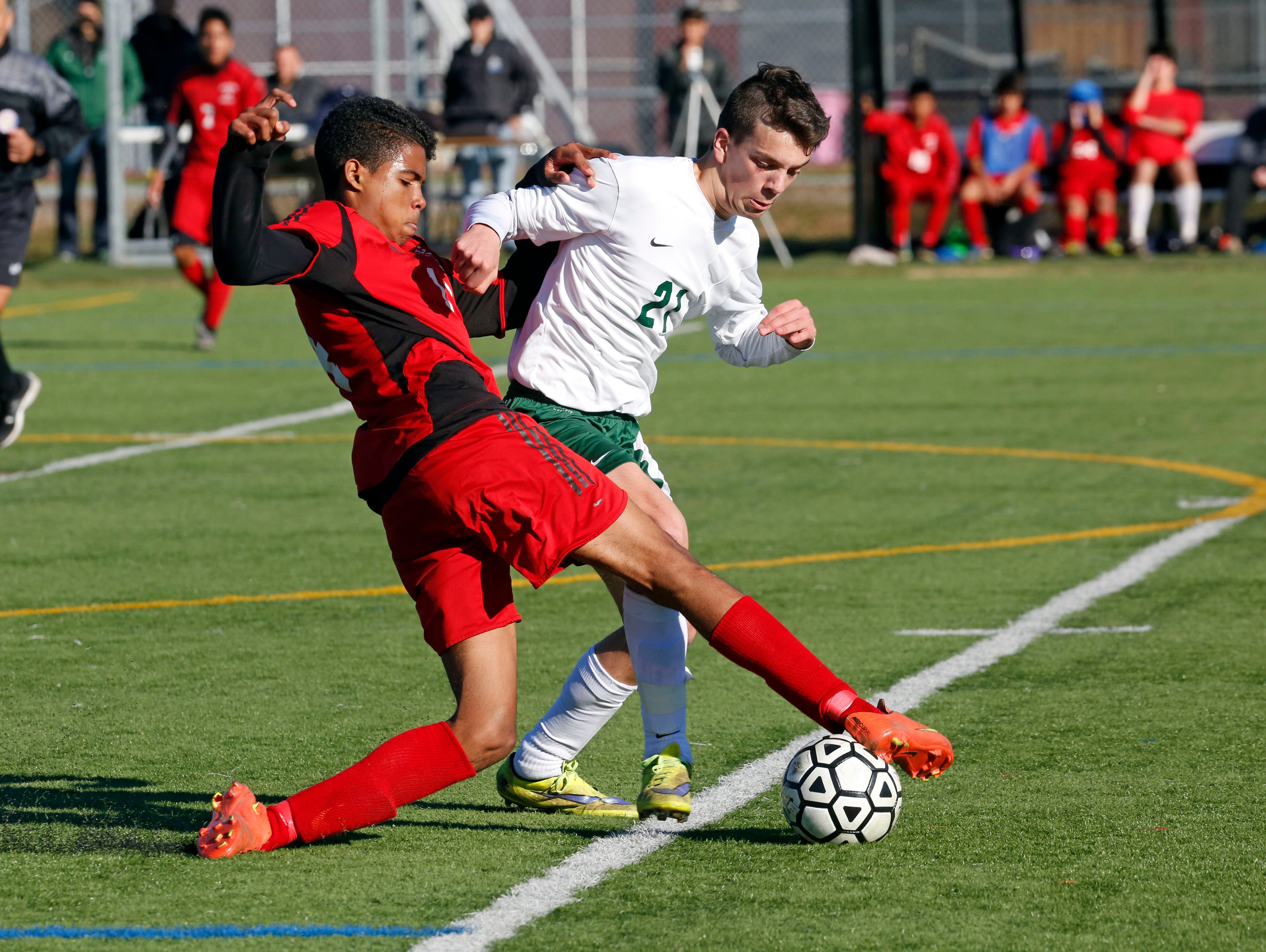 Hamilton's Christian Sanchez and Solomon Schechter's Cameron Roth battle for possession during the Class C boys soccer final Oct. 30, 2015 at Arlington High School in Lagrangeville. Solomon Schechter won, 2-1, in overtime.