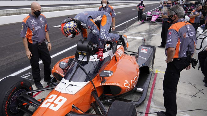 James Hinchcliffe prepares for a run at the Indianapolis Motor Speedway, where the drivers say the atmosphere is much different without fans.