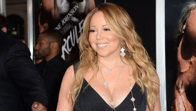 """Singer Mariah Carey attends the premiere of """"Hercules,"""" July 23, 2014 at TCL Chinese Theatre in Hollywood, California."""