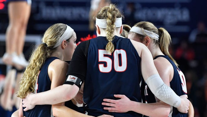 Belmont players huddle during a timeout during the second half against Duke in the 2018 NCAA Division I Women's Basketball Tournament Saturday March 17, 2018, in Athens, Ga.
