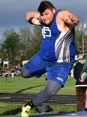 Fort Defiance's Zach Boyers competes in the boys shot put during a six-team track and field meet at Waynesboro High School on Wednesday, April 19, 2017, in Waynesboro, Va.
