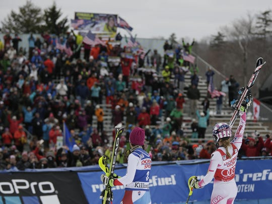 Mikaela Shiffrin of the United States (right) waves to the crowd after the second run in the women's slalom race in the FIS alpine skiing World Cup at Killington Resort.