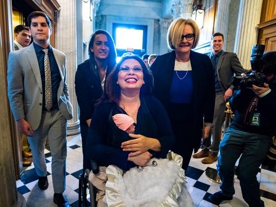 Democratic Senator from Illinois Tammy Duckworth carries
