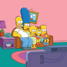 The Simpsons are in front of their TV. Why aren't you?