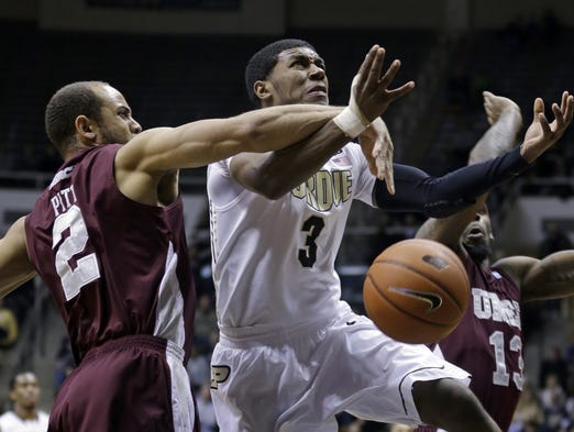 Purdue guard Ronnie Johnson, right, is fouled as he shoots by Maryland-Eastern Shore guard Ishaq Pitt in the first half of an NCAA college basketball game in West Lafayette, Ind., Tuesday, Dec. 17, 2013. (AP Photo/Michael Conroy)