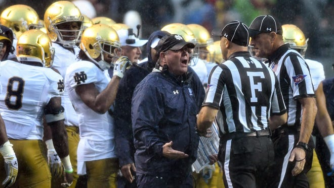Notre Dame coach Brian Kelly argues a penalty call in the first quarter against the North Carolina State Wolfpack at Carter-Finley Stadium.