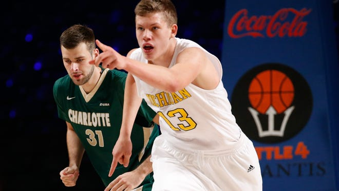 Michigan forward Moritz Wagner (13) reacts after scoring against Charlotte in the first half during the 2015 Battle 4 Atlantis in the Imperial Arena at the Atlantis Resort on Thursday.
