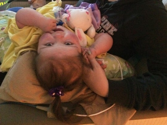 Zoey Jones, 3, and her mother Tori Goddard, celebrate after learning Zoey would no longer need a heart-lung transplant, thanks to a special redirect surgery at Nationwide Children's Hospital.