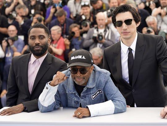 "Director Spike Lee, center, poses with his ""BlacKkKlansman"""