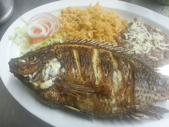 Mojarra frita, or fried tilapia, at Taqueria La Reata