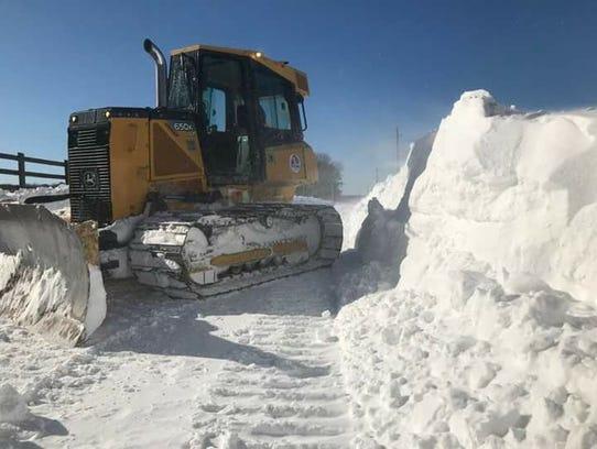 Major Jones of Bayford, Virginia cleans up snow in