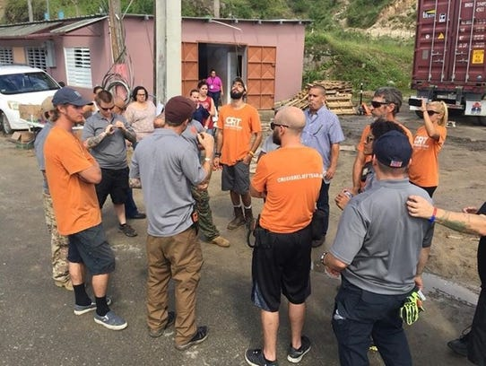 A group of veterans from the U.S. help distribute supplies