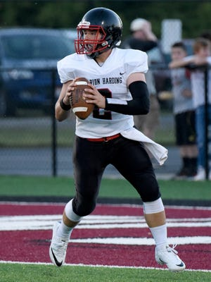 Harding senior quarterback Ryan Sayre drops back to pass at Newark earlier this season. The Presidents will take on Jonathan Alder on Friday at 7 p.m. in Harding Stadium in a game that will be for first place in the Mid Ohio Athletic Conference Red Division.