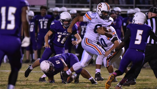 Darian Burns races ahead for a Dickson County first down against Clarksville.