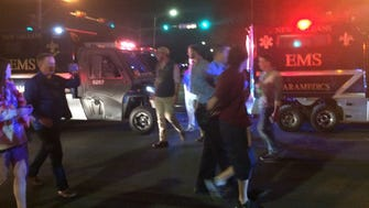 Police in New Orleans arrest a man after a truck crashed into paradegoers on Saturday, Feb. 25, 2017.